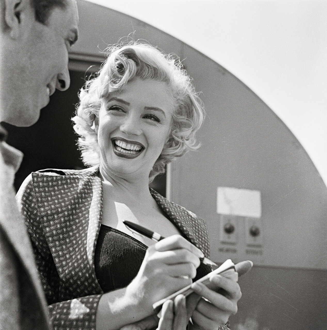 Portrait of Marilyn Monroe Signing Autograph for Young Man