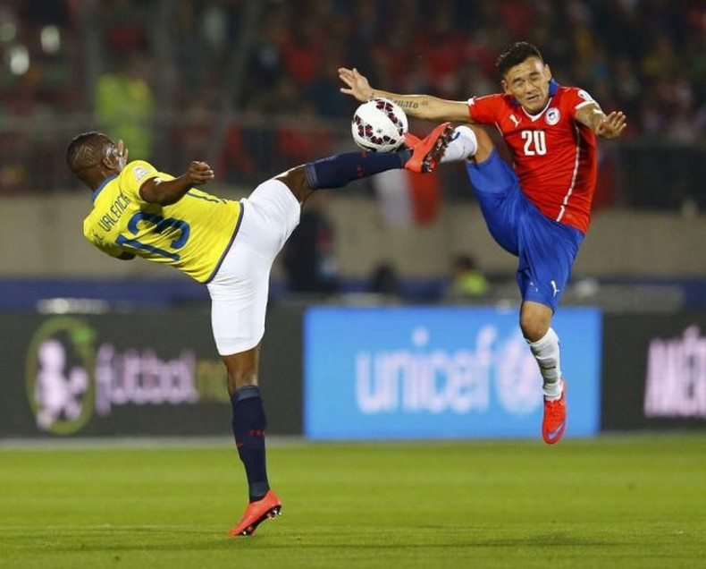 Ecuador's Valencia and Chile's  Aranguiz jump for the ball during the opening soccer match of the Copa America 2015 at the National Stadium in Santiago