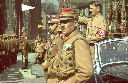 Hitler salutes German troops in Adolf Hitler Platz on September 1st, 1938. 'The very first essential for success,' Hitler once said, 'is a perpetually constant and regular employment of violence'