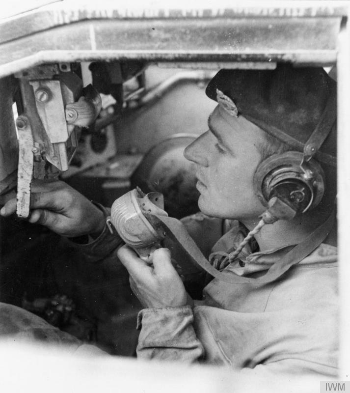 "View inside the driver""s compartment of a Valentine tank, showing the driver talking into the intercom, 27 March 1942."