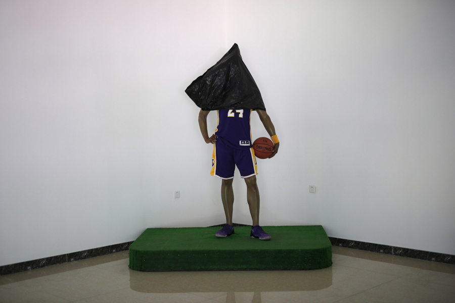 A wax figure of Los Angeles Lakers forward Kobe Bryant with its head covered to protect it from dust