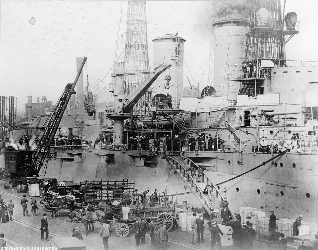 USS NEW YORK (BB-34) Loading stores at the Brooklyn Navy Yard before 1917