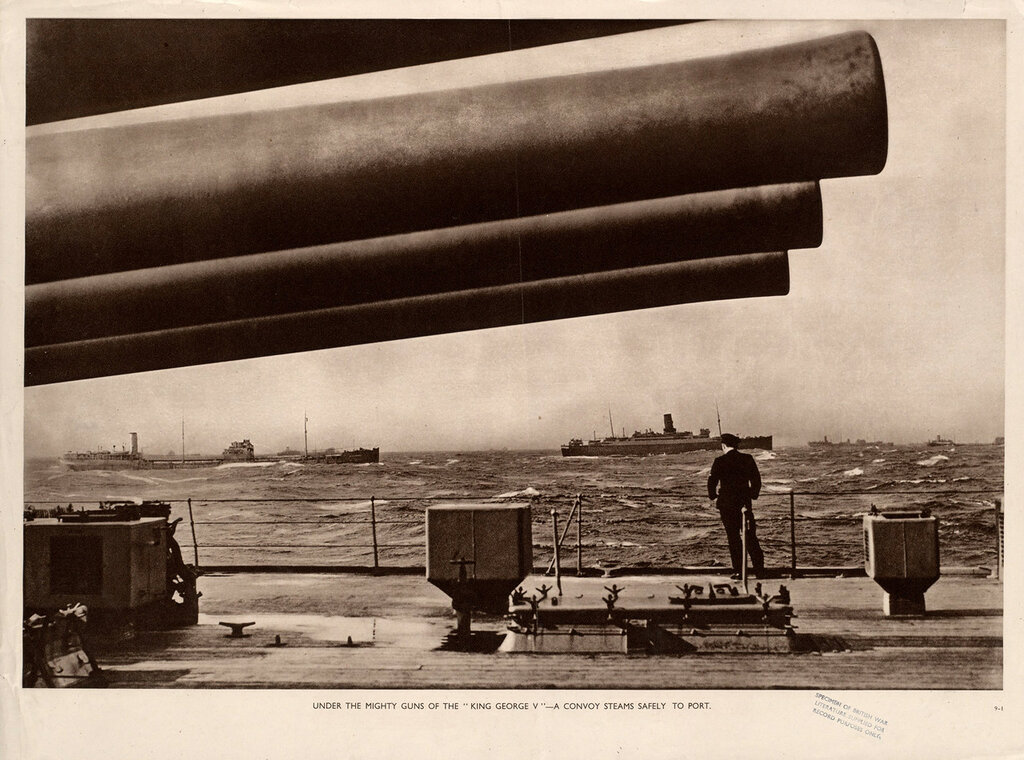 "Under the mighty guns of the ""King George V"" - a convoy steams safely to port"