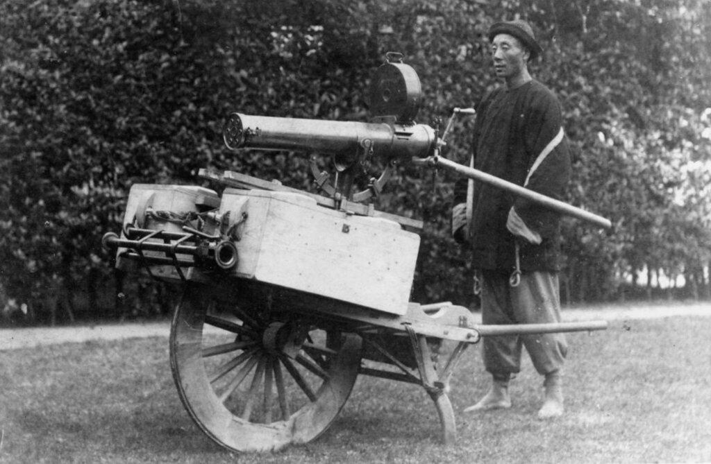 "Gatling machine gun. Mounted on a Chinese ""wheel-barrow""; transport, circa 1880s. Photo by Cheung-Chun, Shanghai"