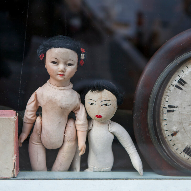 vintage dolls with clock on flea-market