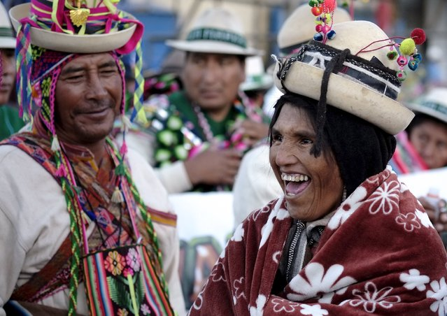 Indigenous people joke during the Anata Andina (Andean carnival) parade in Oruro, February 4, 2016.