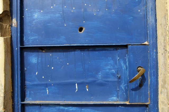 A bullet hole is seen on the door of a house in Gyallesu district after recent clashes between Shi&#