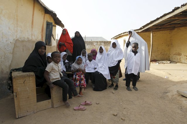 Islamic students pose for a picture outside their classroom at a Shi'ite school in Zaria, Kadun
