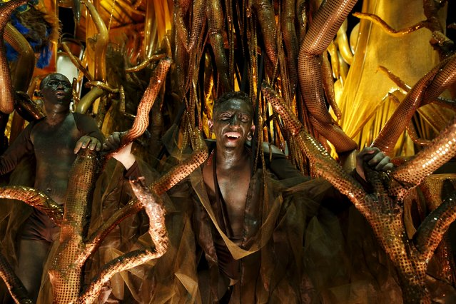 Revellers of Vila Isabel samba school perform during the carnival parade at the Sambadrome in Rio de