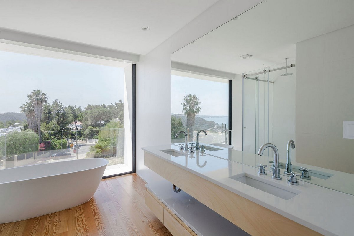 JC House, JPS Atelier, частные дома в Португалии, планировка частного дома фото, солнечные батареи в частном доме фото, стеклянные перила балкона фото