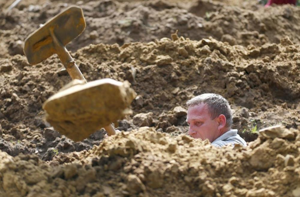Gravedigger competes in Hungarian grave digging championship in Debrecen