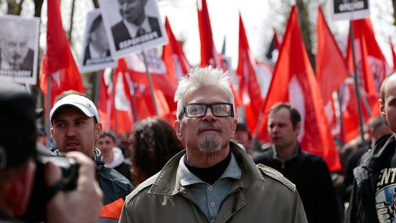 Opposition leader Eduard Limonov leads his supporters as they take to the streets to mark May Day in Moscow, Russia, on Wednesday, May 1, 2013. Thousands of Communists, members of Russia's main political parties and opposition activists staged competing m