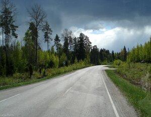 Просёлочными дорогами.