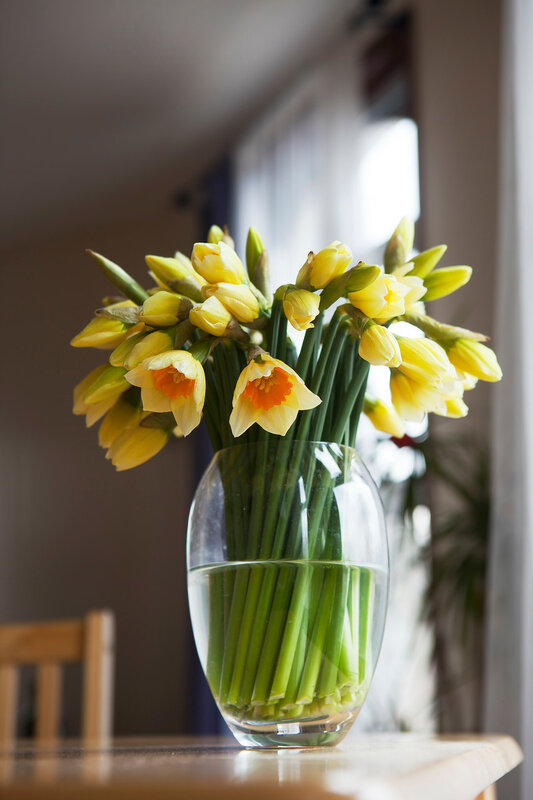 bouquet of daffodils on weathered wooden table