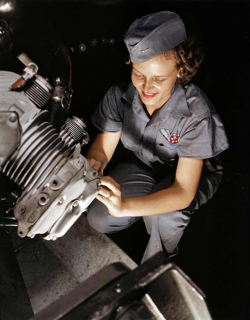 August 1942. Mechanic Mary Josephine Farley works on a Wright Whirlwind motor in the Corpus Christi, Texas, Naval Air Base assembly and repairs shop.jpg