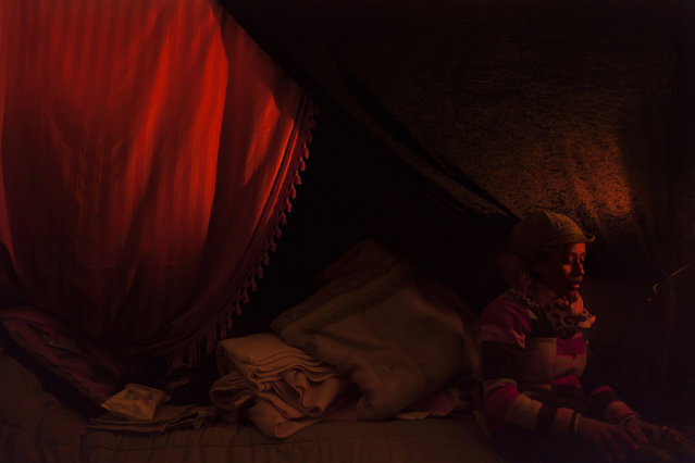 Yiogos Doukanaris, Greece. Shortlisted, Open Competition, Low Light. A refugee woman sitting inside