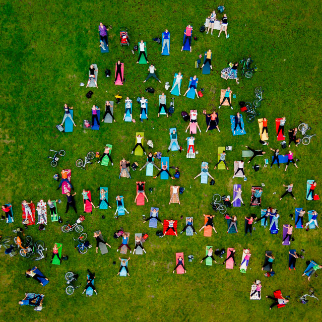 Karolis Janulis, Lithuania. Open Competition; People. People take part in a mass yoga exercise in th