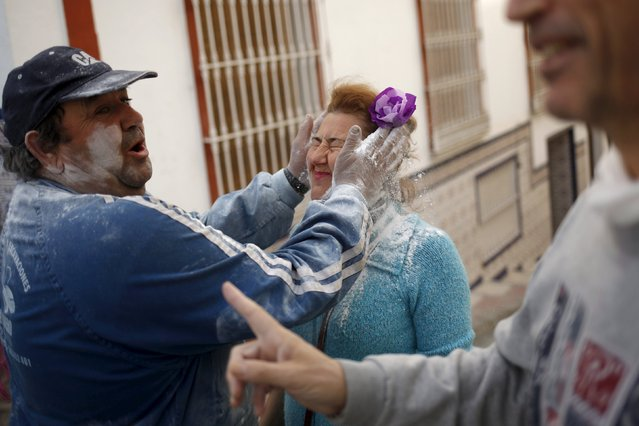 "A man covers the face of a woman with talcum powder during ""El Dia de los Polvos"" (Powder Day) festi"