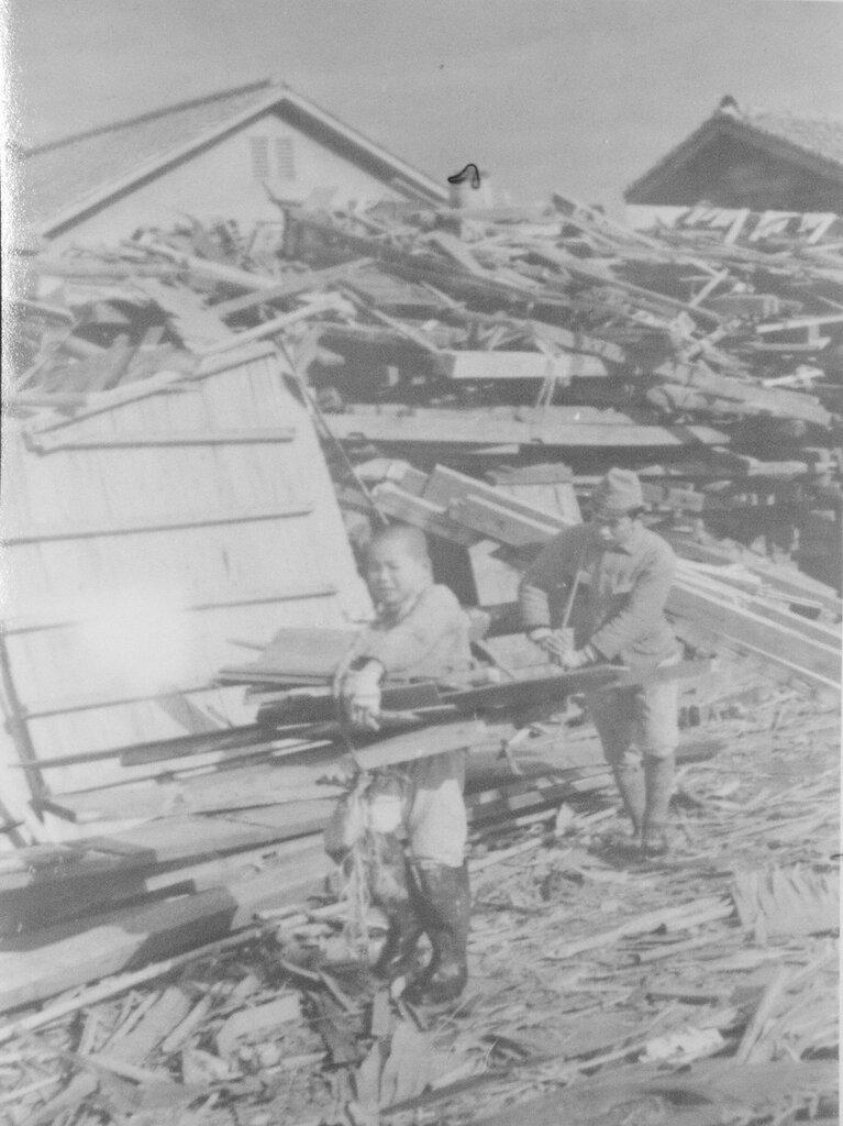 Salvaging scrap wood, Dec 1945