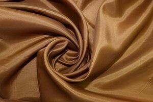 ПС1024 остаток  3,80м 150руб-м Подкладочная ткань цвет коньяк,тонкая,легкая,приятная,практически  не прозрачная,вискоза 60%,пэ 40%,ширина 1,40м