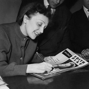 Edith Piaf Autographs a Magazine at the Olympia 1958