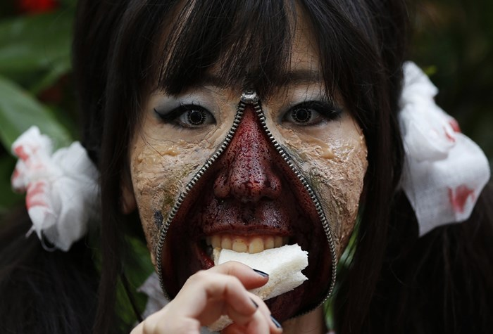 Тыквы и страшные костюмы: мир празднуе Хэллоуин 2014 года