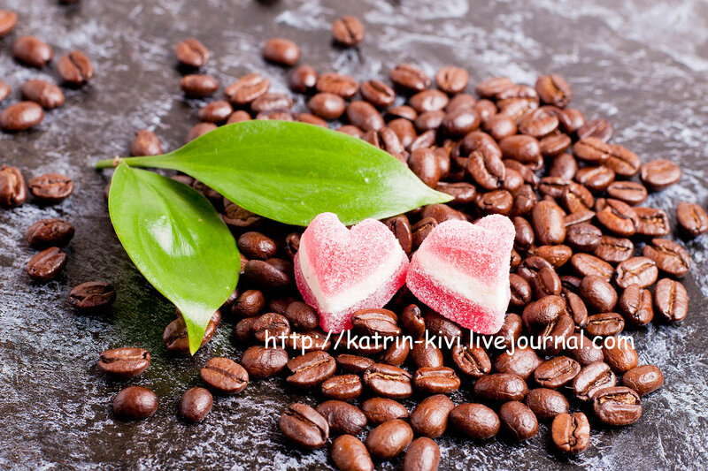 coffee beans and candies on a dark background, close-up
