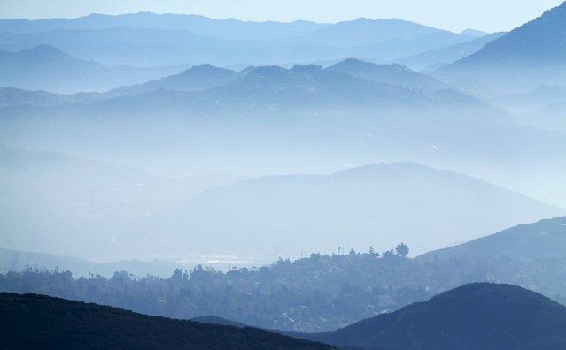 Morning fog covers local inland hillsides near San Marcos, California January 19, 2016. (Photo by Mi
