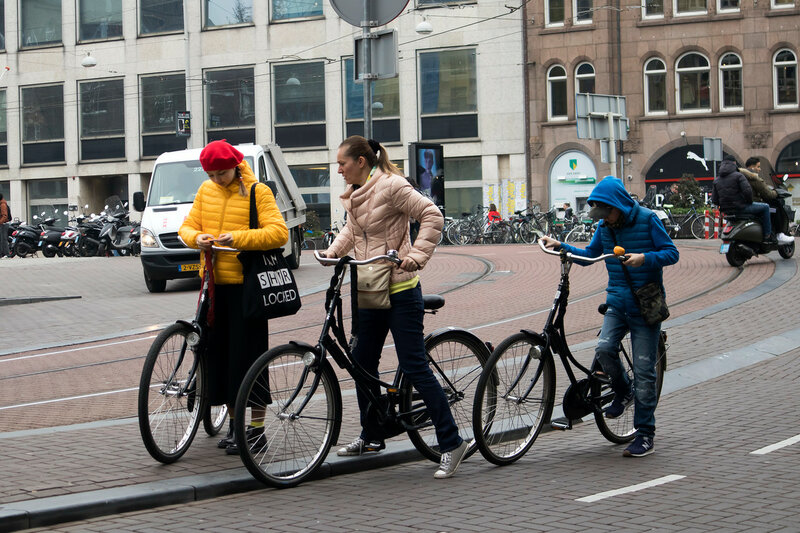 Many people who ride bicycles in a northern europe city