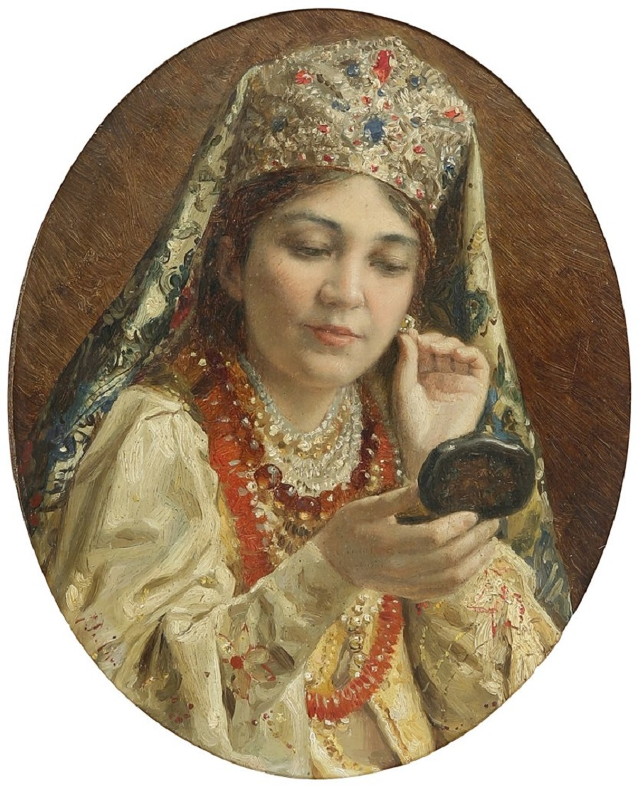WOMAN LOOKING AT EARRING IN POCKET MIRROR