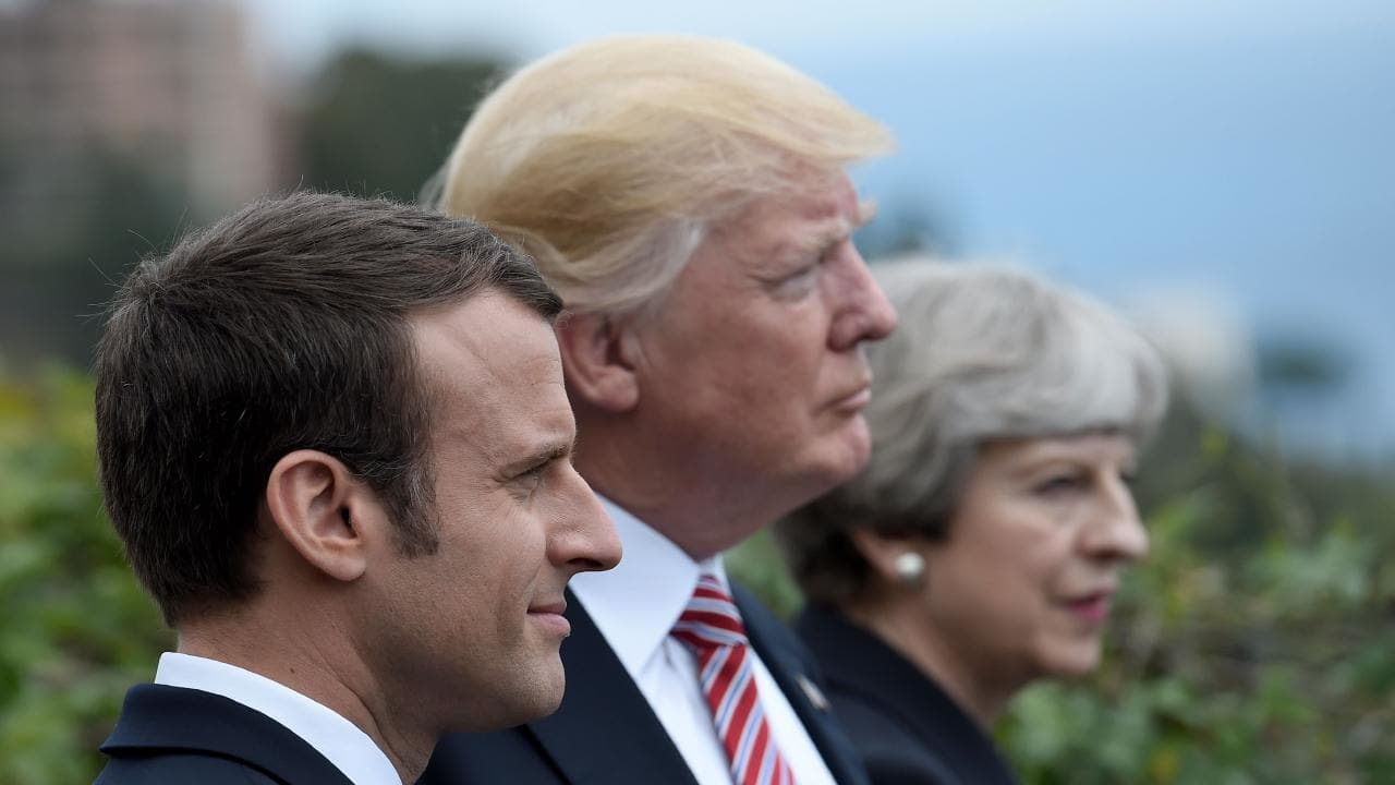 Donald Trump, with French President Emmanuel Macron and British PM Theresa May. Their coalition