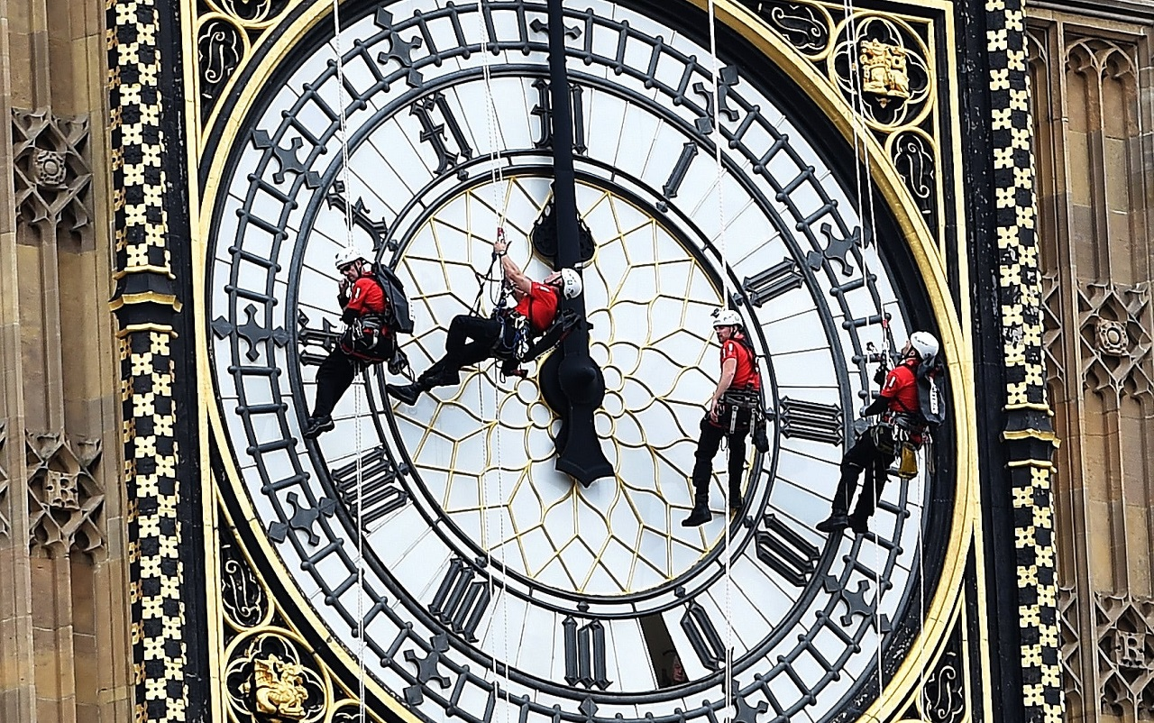 London, UK  People abseil over the clock face on the Elizabeth Tower. The Big Ben bell is to fall silent for four years while repairs are carried out 14 aug, 2017