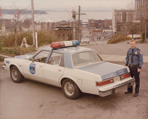 L-Officer-Pat-Wallace-with-Car-No-338A-1-1981-Dodge-Diplomat-1.jpg