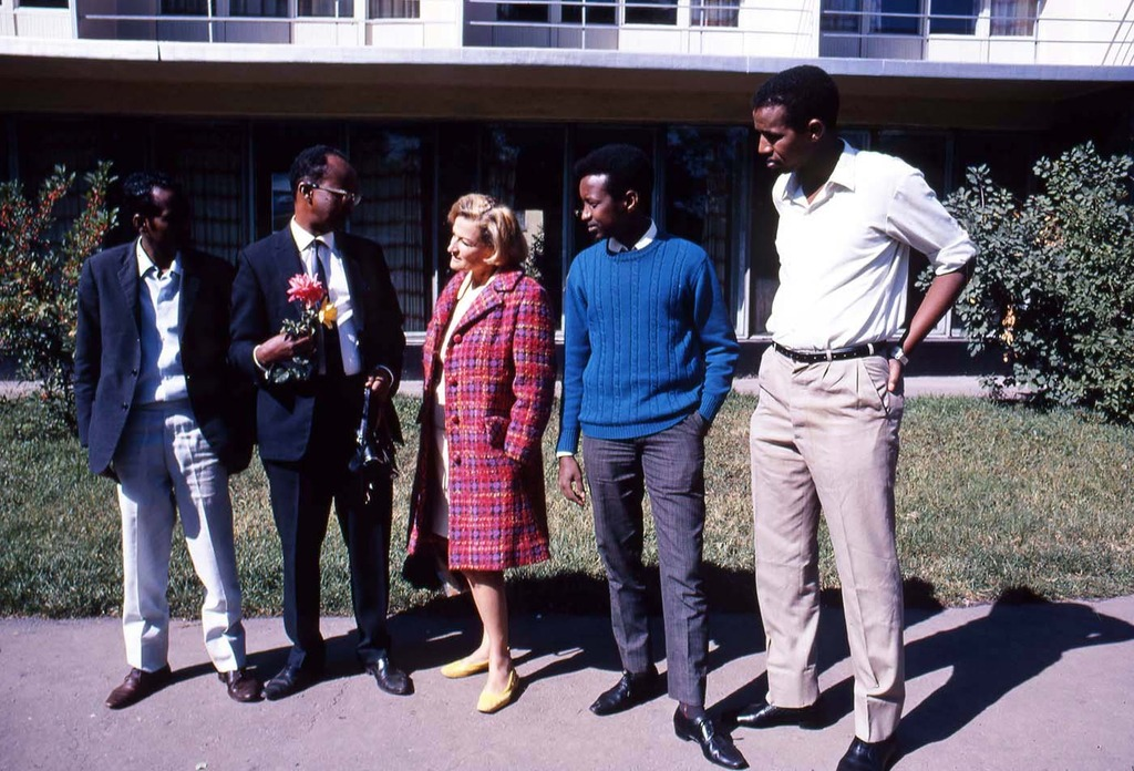 Phyliss Snider standing with some students attending University of Alma-Ata.JPG