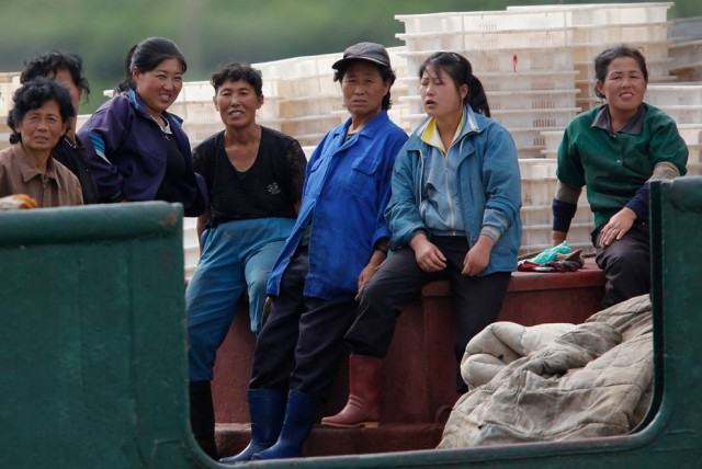Female workers takes a break on a fishing boat at the port of Rajin, in North Korean Special Economi
