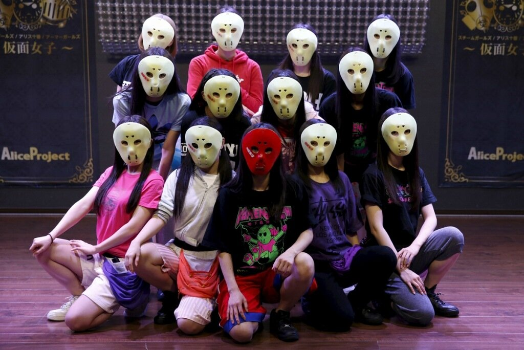 """Members of Japanese idol group Kamen Joshi (Masked Girls)  pose for a photo after a rehearsal for a concert at their theatre in Tokyo's Akihabara district, Japan March 17, 2016. For countless girl and pop-idol bands in Japan, standing out from the crowd can be daunting, but one group - """"Kamen Joshi"""" - seems to have found the answer by hiding behind masks. The Tokyo-based all female band has 18 members, split into three groups that perform across Japan and elsewhere in Asia. REUTERS/Toru Hanai SEARCH """"KAMEN JOSHI"""" FOR THIS STORY. SEARCH """"THE WIDER IMAGE"""" FOR ALL STORIES - RTSCLUW"""
