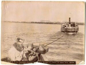 Переправа пассажиров через реку Иртыш у Омска (во время хода парохода и общий вид города