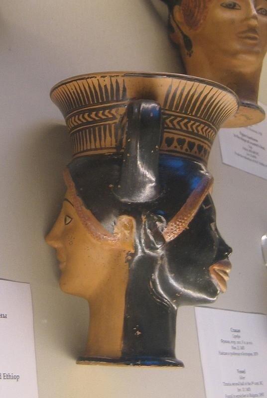 Фигурный канфар в виде голов эфиопа и женщины
