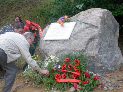 Утром 4 июля 1942 года в деревню Буда вошел карательный отряд фашистов. Мужчин и мальчиков (84 человека) фашисты вывели за околицу и расстреляли. Женщины с детьми пытались укрыться в погребах и домах, но каратели поджигали дома, бросали гранаты в погреба.