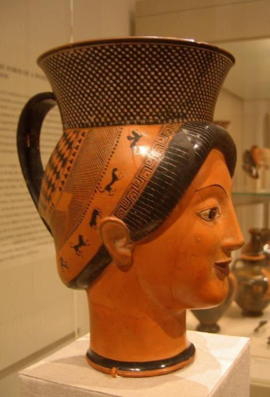 Фигурный сосуд в виде женской головы