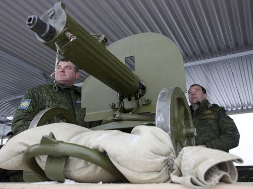 "Russia's President Medvedev and Defence Minister Serdyukov inspect an armoury exhibition at the firing ground ""Shot"" in the Moscow region"
