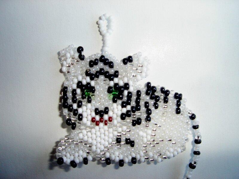 Белый тигренок.