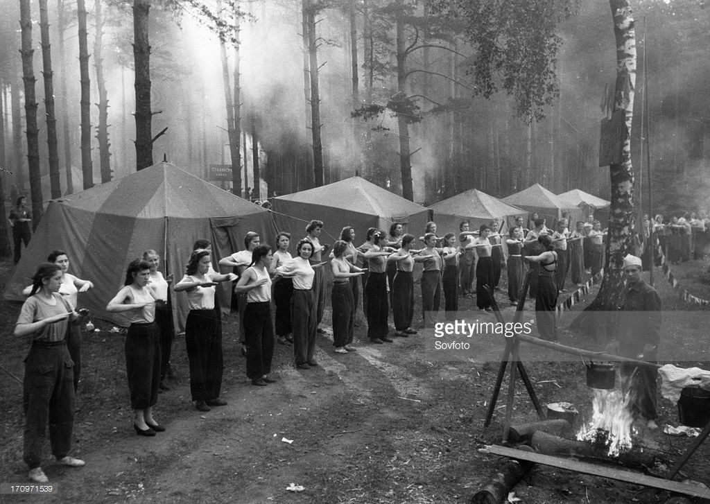 Soviet health spa, a group of women doing their morning exercises at a camp in the moscow region, june 1953.jpg