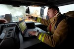 Firefighter in Truck Using Latitude 14 Rugged Extreme