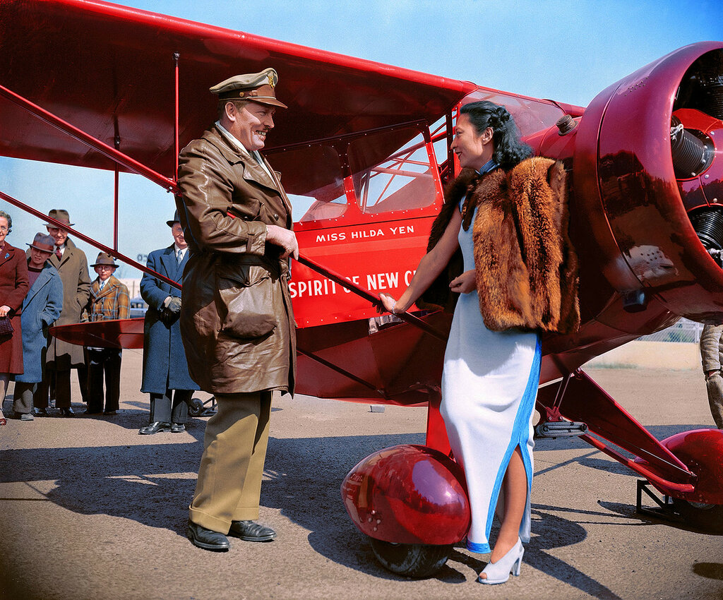 April 3, 1939. Washington, D.C. Col. Roscoe Turner, winner of speed trophies in the air, at Washington Airport and Miss Hilda Yen, Chinese Aviatrix (colorized)