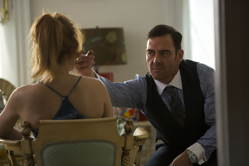 Teddy (MARTON CSOKAS, right) pays Mandy (HALEY BENNETT) a visit in Columbia Pictures' THE EQUALIZER.