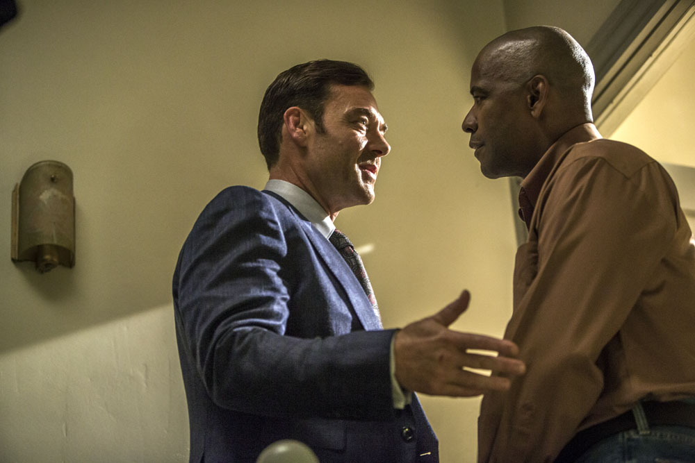 Teddy (MARTON CSOKAS, left) meets McCall (DENZEL WASHINGTON) at his apartment in Columbia Pictures' THE EQUALIZER.