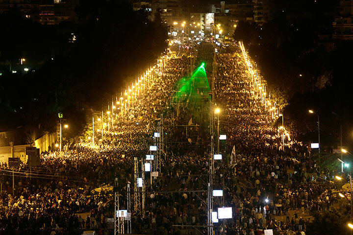 Protesters gather outside the presidential palace after braking through