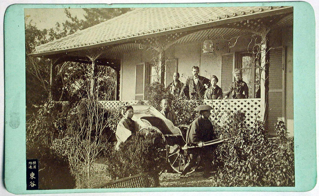 Japanese house with porch, rickshaw, and western people, 1860 - ca. 1900