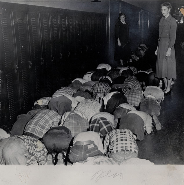 Students at Ockley Green Public School, Portland, Oregon, practice duck and cover drill for possible atomic bomb attack